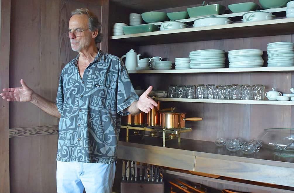 Bob Liljestrand showing the china cabinet