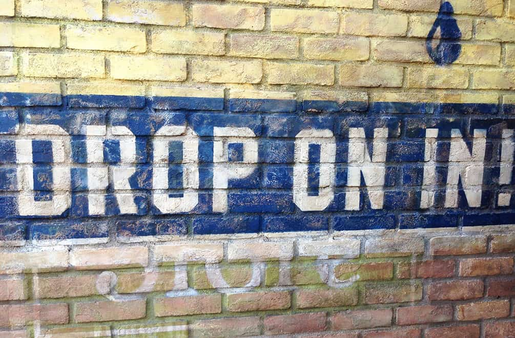 "The ""Drop In"" painted wall sign at Radiator Springs in California Adventure."