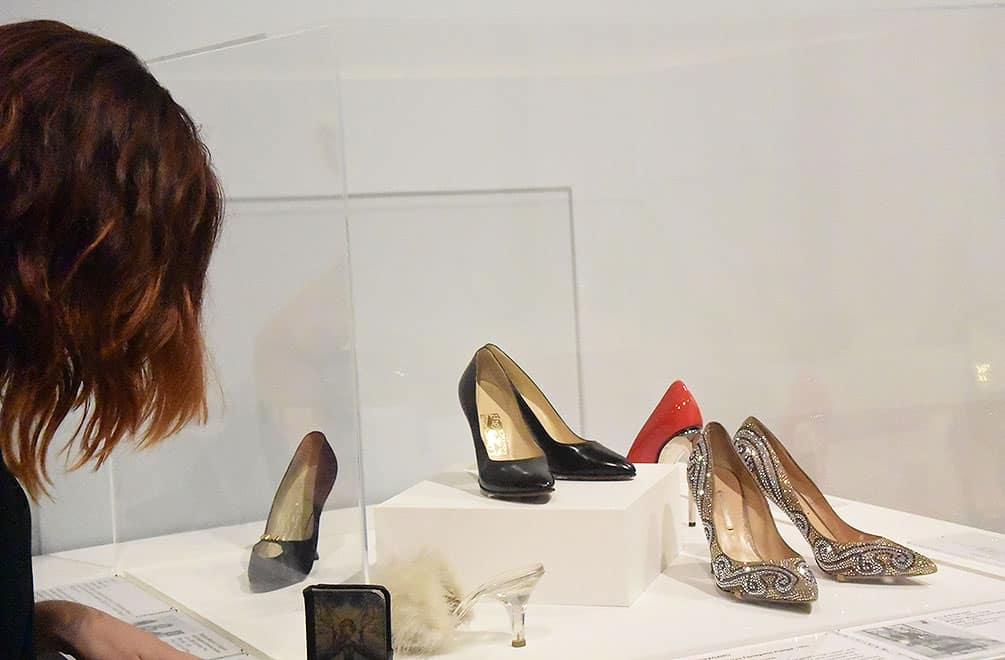 Woman looking at Killer Heels exhibit