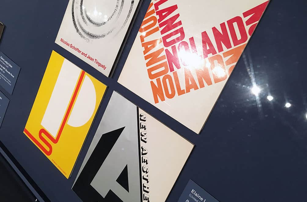 Elaine Lustig catalogs under glass