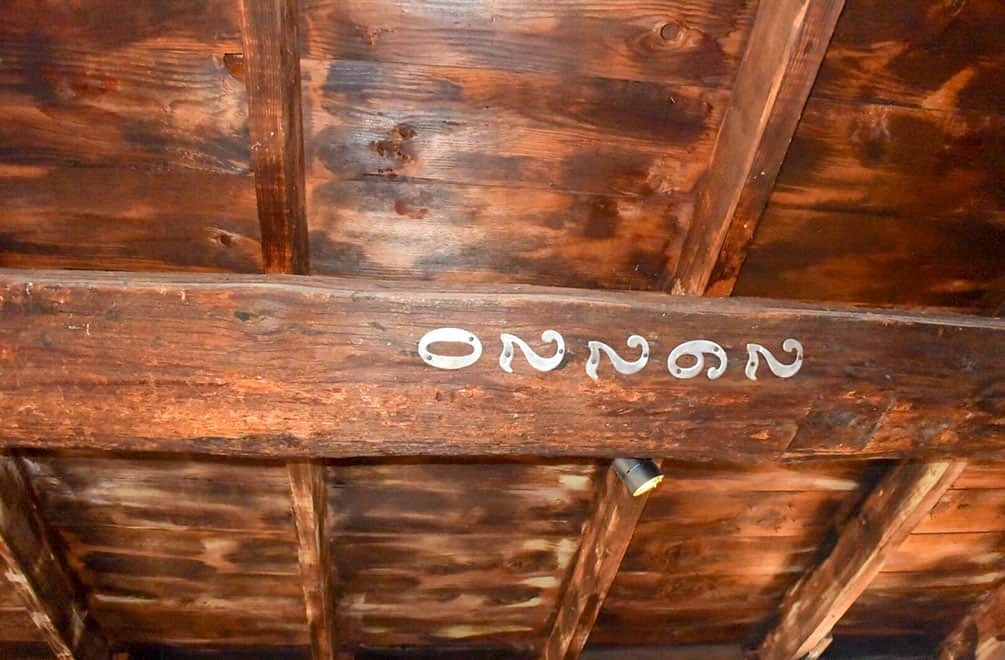 Reused wood with street numbers on ceiling at Cabot's Pueblo Museum