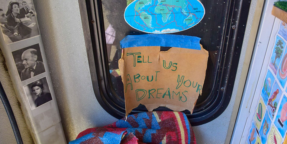 Tell Us About Your Dreams sign in the Dream Wanderer bus